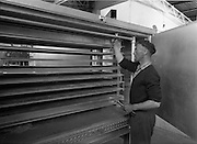 14-15/ 05/ 1959<br /> 05/14-15/1959<br /> 14-15 May 1959<br /> Engineer Colm O Labhrada prepares the refrigerator at the Gael Linn fish and vegetable processing plant, Carna, Co. Galway.