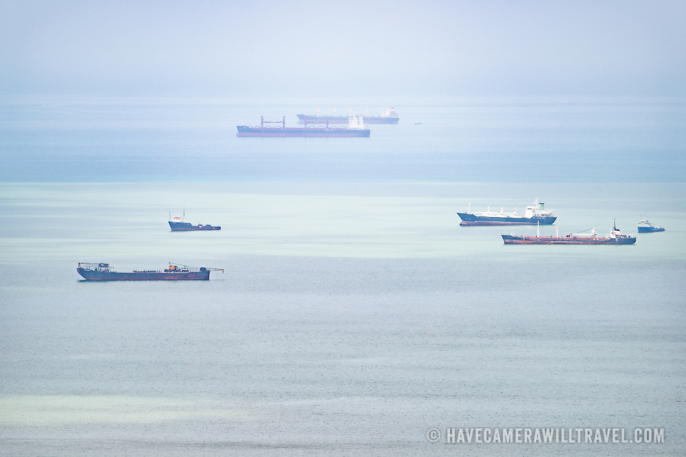 Ships anchored waiting for their instructions to enter the Panama Canal, as seen from the top of Ancon Hill. Ancon Hill is only 654-feet high but commands an impressive view out over the new and old sections of Panama City. With views out over both the Pacific Ocean and the entrance to the Panama Canal, the area was historically where the administration of the Panama Canal was centered and now has a mix of high-end residences and government departments.