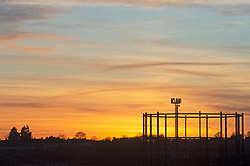 © Licensed to London News Pictures. 13/02/2019. Orpington. Orpington gas holder station with sunset. The sunsets over South East London tonight as Valentines day tomorrow looks set to be sunny and warm. Photo credit: Grant Falvey/LNP