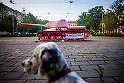 """Rudy The Therapist posing in front of the """"Pink Tank"""" by Czech artist David Cerny."""