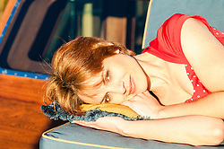 redheaded woman outdoors enjoying a relaxing afternoon in the sun
