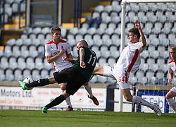 Raith Rovers Martin Scott has a shot blocked by Falkirk's Owain Tudor Jones.<br /> half time : Raith Rovers 0 v 0 Falkirk, Scottish Championship game played 27/9/2014 at Raith Rovers Stark Park.