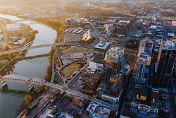Morning aerial image of the Pinnacle Building and the Gateway Bridge, John Seigenthaler pedestrian bridge over 2nd Avenue and the Cumberland River in Nashville, Tennessee.