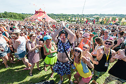 © Licensed to London News Pictures. 25/06/2015. Pilton, UK. A Lionel Richie flashmob takes place at Glastonbury Festival 2015, with a whole field of festival goers participating, on Thursday Day 2 of the festival.  This years headline acts include Kanye West, The Who and Florence and the Machine, the latter having been upgraded in the bill to replace original headline act Foo Fighters.   Photo credit: Richard Isaac/LNP