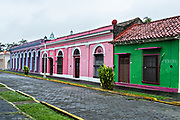 Brightly painted colonnaded style homes in Tlacotalpan, Veracruz, Mexico. The tiny town is painted a riot of colors and features well preserved colonial Caribbean architectural style dating from the mid-16th-century.