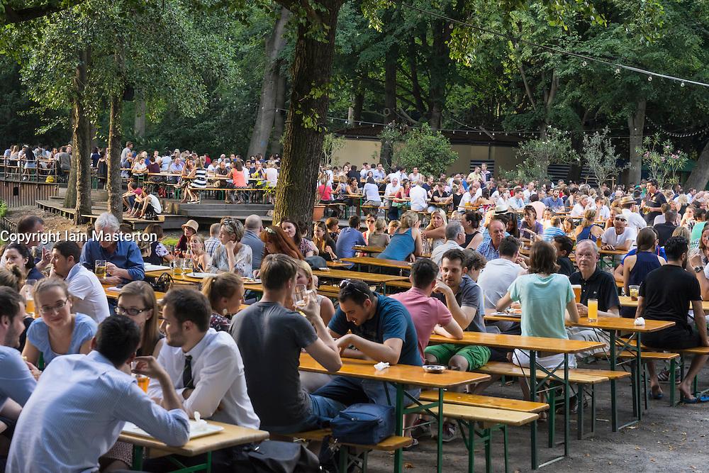 Busy beer garden in summer at Cafe am Neuen See in Tiergarten park in Berlin Germany