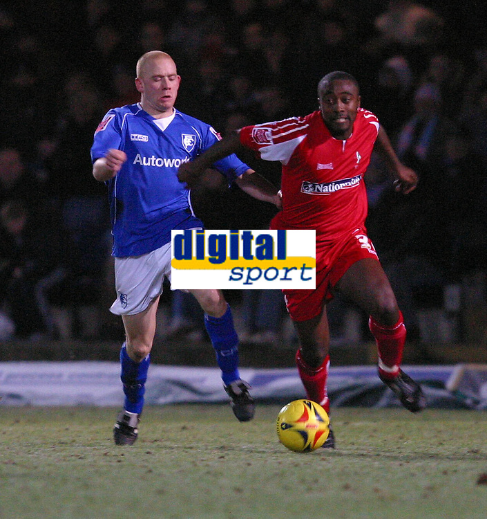 Photo: Dave Linney.<br />Chesterfield v Swindon Town. Coca Cola League 1.<br />28/12/2005.  Aaron Brown(Swindon) heads for goal after beating Sammy Clingan(Chesterfield)