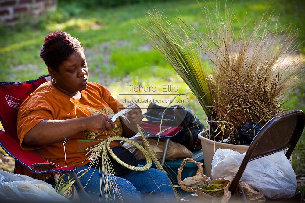 Gullah sweetgrass basket weaver at Boone Hall Plantation in Charleston, SC.