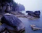 Foggy shoreline of Lake Huron's Georgian Bay near Halfway Rock Point, Bruce Trail, Bruce Peninsula National Park, Ontario, Canada.