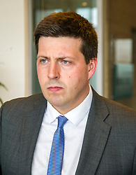 Pictured: Jamie Hepburn<br /> <br /> Employment Minister Jamie Hepburn visited Maclay Murray and Spens today as the latest unemployment figures were released. Mr Hepburn met employees who have benefited from family-friendly working policies. He was welcomed to Quatermile One by Amanda Jones, Partner and Head of Dispute, Claire Maclean (Senior Solicitor) and her three year old son Jack, and Alan Delaeny, Director<br /> of Employment, Pensions and Immigration.<br /> Ger Harley | EEm 14 June  2017