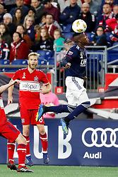 September 22, 2018 - Foxborough, MA, U.S. - FOXBOROUGH, MA - SEPTEMBER 22: New England Revolution midfielder Luis Caicedo (27) heads the ball during a match between the New England Revolution and the Chicago Fire on September 22, 2018, at Gillette Stadium in Foxborough, Massachusetts. The teams played to a 2-2 draw. (Photo by Fred Kfoury III/Icon Sportswire) (Credit Image: © Fred Kfoury Iii/Icon SMI via ZUMA Press)