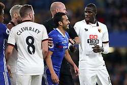 15 May 2017 - Premier League Football - Chelsea v Watford - Abdoulaye Doucoure of Watford argues with a grinning Pedro of Chelsea - Photo: Charlotte Wilson