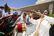 18 MAY 2008 -- MARICOPA, AZ: Musicians play as people process around the temple during the dedication of a new Hindu temple in Maricopa, AZ, Sunday. More than 3,000 Hindus from Arizona, southern California and New Mexico came to Maricopa, a small town in the desert about 50 miles south of Phoenix, for the dedication of the Maha Ganapati Temple of Arizona. It is the first Hindu temple in Arizona designed according to ancient South Indian Hindu architectural guides. Craftsmen from India came to Maricopa to complete the interior details of the temple. The dedication ceremonies lasted three days.   Photo by Jack Kurtz / ZUMA Press