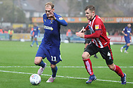 AFC Wimbledon midfielder Mitchell (Mitch) Pinnock (11) taking on Lincoln City midfielder Michael O'Connor (4) during the EFL Sky Bet League 1 match between AFC Wimbledon and Lincoln City at the Cherry Red Records Stadium, Kingston, England on 2 November 2019.