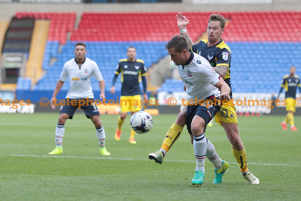 Bolton Wanderers defender Andrew Taylor (20) fends off Oxford United striker Chris Maguire (10) during the Sky Bet League 1 match between Bolton Wanderers and Oxford United at the Macron Stadium in Bolton. October 1, 2016.<br /> Nigel Pitts-Drake / Telephoto Images<br /> +44 7967 642437