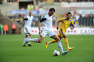 Angel Rangel of Swansea City.<br /> UEFA Europa league, play off round, 1st leg match, Swansea city v FC Petrolul Ploiesti at the Liberty stadium in Swansea on Thursday 22nd August 2013. pic by Phil Rees , Andrew Orchard sports photography,