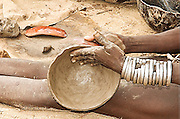 Africa, Ethiopia, Omo Valley, Karo tribesmen woman making clay pottery