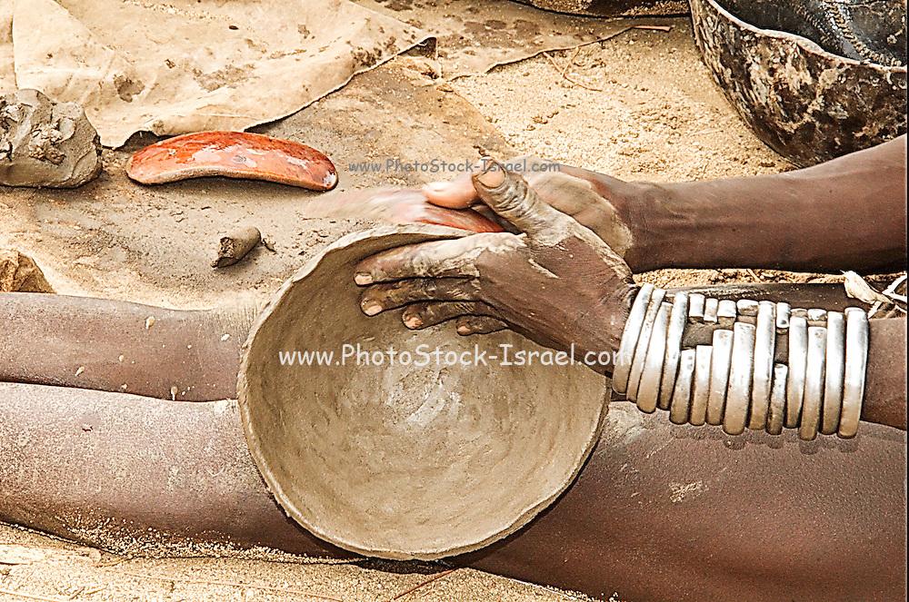 Africa, Ethiopia, Omo Valley, Karo tribesmen woman making clay pottery