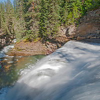 The West Fork of the Gallatin River pours over Ouzel Falls in the Madison Range of the Rocky Mountains, near Big Sky, Montana.
