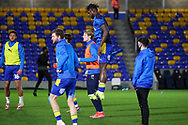 AFC Wimbledon defender Darnell Johnson (27) jumping in warm up during the EFL Sky Bet League 1 match between AFC Wimbledon and Gillingham at Plough Lane, London, United Kingdom on 23 February 2021.