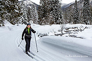 Cross country skiing along the Salmo River near Nelson, British Columbia, Canada model released