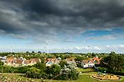 Het bungalowpark De Banjaard in Noord-Beveland met in de achtergrond de windmolens.<br /> <br /> Bungalow park De Banjaard in Noord-Beveland with wind mills in the background.