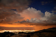 September 7, 2014, Tucson, Arizona, USA: Visitors to Windy Point on Mount Lemmon take in a monsoon sunset and the city lights on the night of the full moon in the Santa Catalina Mountains, Coronado National Forest, Sonoran Desert, Tucson, Arizona, USA.