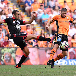 BRISBANE, AUSTRALIA - DECEMBER 11: Dimitri Petratos of the Roar and Tarek Elrich of Adelaide United compete for the ball during the round 10 Hyundai A-League match between the Brisbane Roar and Adelaide United at Suncorp Stadium on December 11, 2016 in Brisbane, Australia. (Photo by Patrick Kearney/Brisbane Roar)