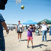 Addison Pete, 6, of Rehoboth shoots a basketball as part of Kid's Day activities set up by the Navajo Housing Authority Thursday, Sept. 5, at the Navajo Nation Fair in Window Rock.