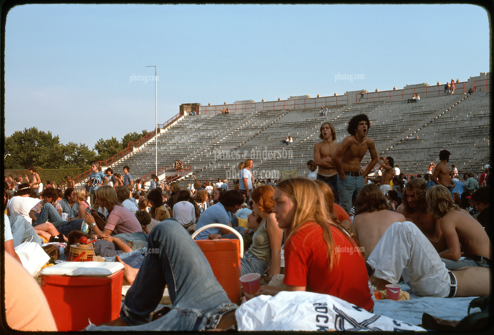 The crowd, deadheads, and the venue before the Grateful Dead Concert begins at Roosevelt Stadium 4 August 1976. View probably not far from home plate, facing south-southeast.