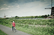 Bike lanes run along the canals and windmills in Kinderdijk.