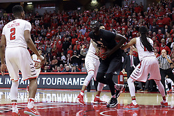 20 March 2017:  Phil Fayne(10) tries to tie up the ball with Tacko Fall during a College NIT (National Invitational Tournament) 2nd round mens basketball game between the UCF (University of Central Florida) Knights and Illinois State Redbirds in  Redbird Arena, Normal IL