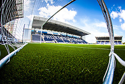 The new plastic pitch and the Main stand seen through the goal net, at The Falkirk Stadium, or the Scottish Championship game v Hamilton. The woven GreenFields MX synthetic turf and the surface has been specifically designed for football with 50mm tufts compared with the longer 65mm which has been used for mixed football and rugby uses.  It is fully FFA two star compliant and conforms to rules laid out by the SPL and SFL.<br /> ©Michael Schofield.