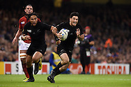 Nehe Milner-Skudder of New Zealand on his way to scoring a try. Rugby World Cup 2015 quarter-final match, New Zealand v France at the Millennium Stadium in Cardiff, South Wales  on Saturday 17th October 2015.<br /> pic by  Andrew Orchard, Andrew Orchard sports photography.