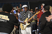 7/19/13 Jackson Mississippi-Legendary blues guitarist Buddy Guy performs as part of the Jackson Rhythm & Blues Festival. Guy, at 76 years old is an amazingly gifted guitarist playing the guitar behind his back, with his butt, with a drum stick and with a towel all without missing a beat. During Buddy Guy's performance he surprised fans by walking around the audience and playing his guitar and at one point he sat in the stands and played while one fan got a little to close and the police had to hold her back. © Suzi Altman/TheOneMediaGroup