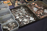 Old coins for sale on a market stall Greenwich London England