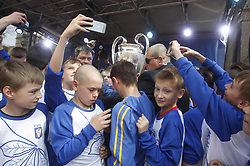 April 21, 2018 - Kiev, Ukraine - Young soccer players take pictures of the UEFA Champions League trophy at the hand over ceremony in Kiev, Ukraine, 21 April, 2018. The Champions League Final is to take place on May 26 at the Olympiyski stadium in Kiev. (Credit Image: © Str/NurPhoto via ZUMA Press)