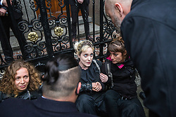 London, UK. 10 June, 2019. Security guards speak to activists from BP or not BP? who evaded them to block access to the National Portrait Gallery in protest against BP's sponsorship of the BP Portrait Award. The energy company has sponsored the National Portrait Gallery's award for 30 years, but its high-profile involvement is attracting widespread criticism due to the intensifying focus on environmental issues. A number of artists, including previous award winners such as Wim Heldens and Craig Wiley, have called on the gallery to end its sponsorship by BP.