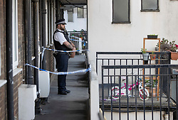 © Licensed to London News Pictures. 01/07/2020. London, UK. A child's bicycle and scooter (R) can be seen as a police officer guards a block of flats in Monarch Parade in Mitcham, south London after a four year old girl was found seriously injured yesterday. She was taken to hospital where she later died. A woman, aged 35, is fighting for her life after she was also found suffering serious injuries inside the property. Photo credit: Peter Macdiarmid/LNP