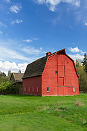 The red Gambrel Roof Barn was built in 1939 on Len Rowlatt's farmland in Langley.  This farmland was first used by Joseph and Sarah Anne Annand and later by Len Rowlatt until his death in 1972.  The property is now part of Campbell Valley Regional Park in Langley, British Columbia, Canada.
