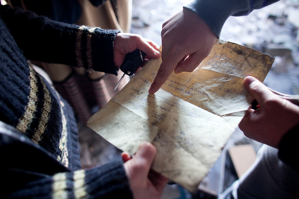 Gammarth, Tunisia. January 29th 2011.A man points out accounting numbers on a sheet of paper he found in  the destroyed and burned house of the first and ex wife of Belhassen Trabelsi who is Leila Trabelsi's older brother..People walked around the house with family and friends. ....