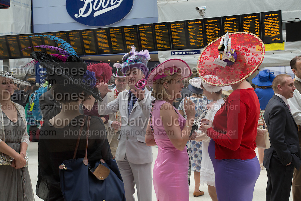 WEARING  FISHHEAD HAT BY ANDREW FISH, Royal Ascot racegoers at Waterloo station. London. 19 June 2013.