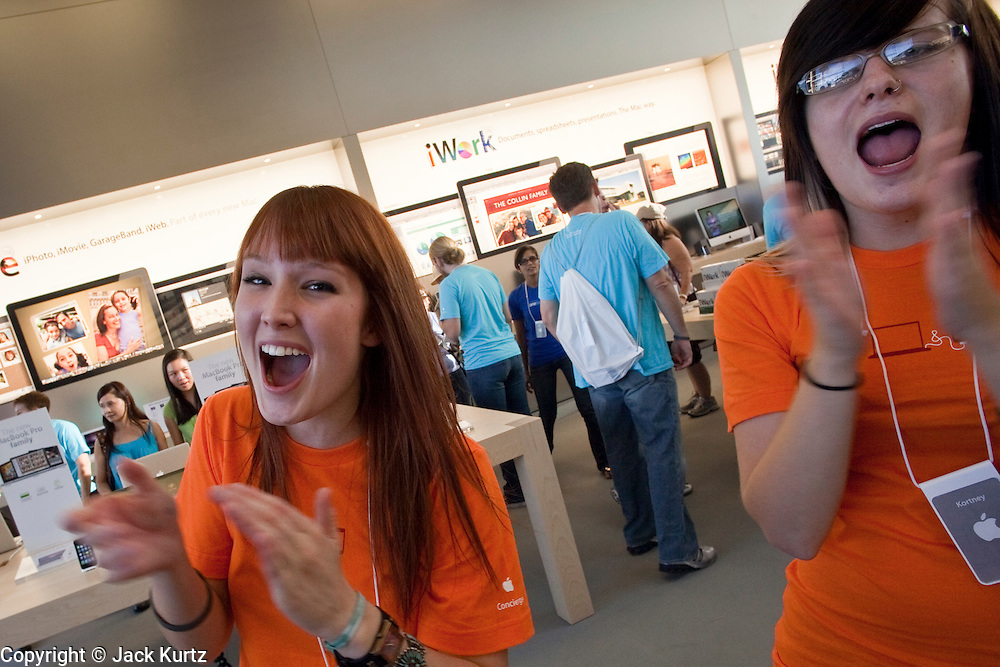 12 JUNE 2009 -- SCOTTSDALE, AZ: Apple Store employees greet shoppers during the store's grand opening Friday. The outlet will be Arizona's largest Apple Store, occupying nearly 10,000 square feet in the Outdoor Lifestyle Center in the Scottsdale Quarter. The store, the fifth in the Phoenix area, uses a radically different design from other Apple Stores in some respects. Ceilings in the building are approximately 20 feet high, and lined with a 75-foot long skylight, reducing dependence on artificial lighting. Aiding the skylight is an all-glass front and rear, permitting visitors to see directly through the store. More than one thousand people lined to get into the store during the grand opening. Photo by Jack Kurtz
