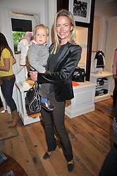 FELICIA BROCKLEBANK and her son FLORIS  at 'Paint Your Polo Celebration' a children's party in aid of the charity Clic Sargent held at Ralph Lauren, 139/141 Fulham Road, London on 28th April 2009.