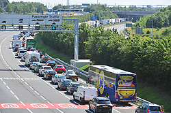 © Licensed to London News Pictures. 23/07/2016<br /> EURO TUNNEL TRAFFIC.<br /> M20 traffic near the Euro Tunnel Service Station at the back of a very very long queue into Dover, kent.<br /> Dover bound traffic ON THE  M20 in Kent at Junction 11A AND 12.  Queueing traffic because of very long delays at French border contol. <br /> <br /> <br /> (Byline:Grant Falvey/LNP)