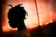 Tuombe, 18, stands by a plastic sheeting at Keshero Hospital in Goma, North Kivu province, Thursday, March 6, 2008. Tuombe said she and her eight-year-old sister, Odetta, were raped by three gunmen from FDLR (Forces Armées de la République Démocratique du Congo) in September 2007 as the two sisters were farming potatoes. Tuombe was discharged from the hospital in mid 2008, and now went back to her village in Numbi, South Kivu.