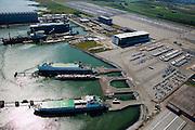 Nederland, Zeeland, Vlissingen-Oost, 12-06-2009; Sloehaven, terminal van autovervoerder Cobelfret. Ferry met als bestemming Engeland wordt geladen met auto's, het binnenvaartschip voert auto's aan. In Vlissingen worden auto's verzameld die in geheel Europa geassembleerd zijn. Vanuit Vlissingen wordt er naar de Britse markt geexporteerd..Swart collectie, luchtfoto (25 procent toeslag); Swart Collection, aerial photo (additional fee required).foto Siebe Swart / photo Siebe Swart