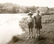 young boy and girl posing by a wide river France ca 1960s