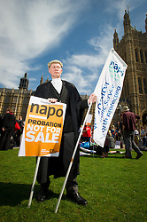 © Licensed to London News Pictures. 01/04/2014. London, UK. Lawyers and probation officers strike and protest at proposed legal aid cuts culminating in a march on the Ministry of Justice. Photo credit : David Tett/LNP
