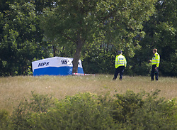 © Licensed to London News Pictures. 08/06/2020. London, UK. Police officers guard a forensics tents at Fryent Country Park near Wembley, north London. According to reports, two women were found unresponsive and were pronounced dead at the scene yesterday. Photo credit: Peter Macdiarmid/LNP